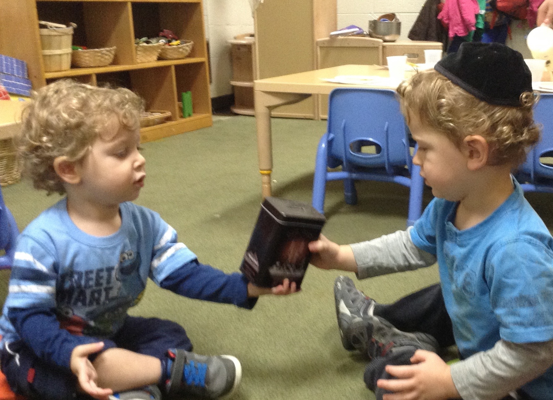 Giving tzedakah. (Twos)