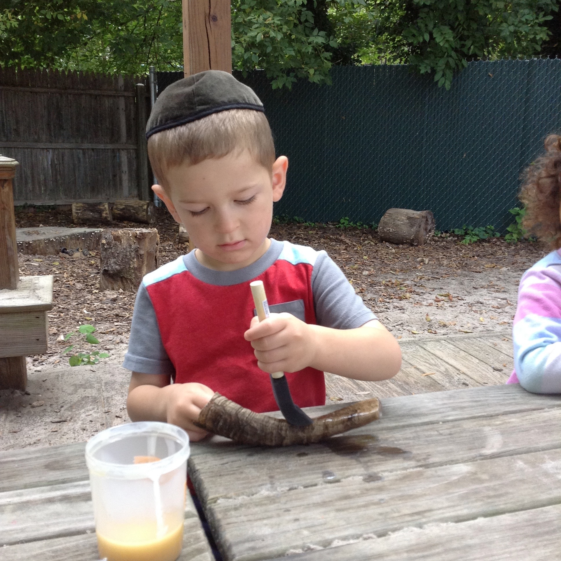 Varnishing a Shofar. (Threes)
